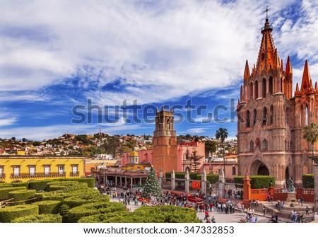 Parroquia Archangel church Jardin Town Square San Miguel de Allende, Mexico. Parroaguia created in 1600s. - stock photo
