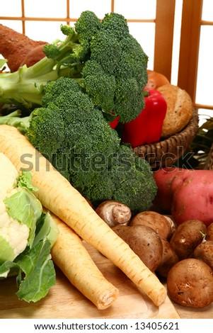 Parsnips, mushrooms, potatoes, broccoli, cauliflower, peppers, in kitchen. - stock photo