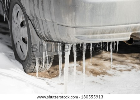 part aitomobilya after freezing rain with icicles - stock photo