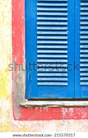 Part of a blue painted window shutter - stock photo