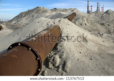 Part of a deactivated buried pipeline. - stock photo