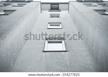 Part of a grey apartment building in Germany - stock photo
