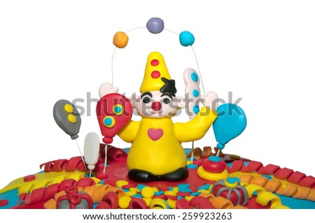Part of a homemade birthday cake with a clown and balloons isolated on white  - stock photo