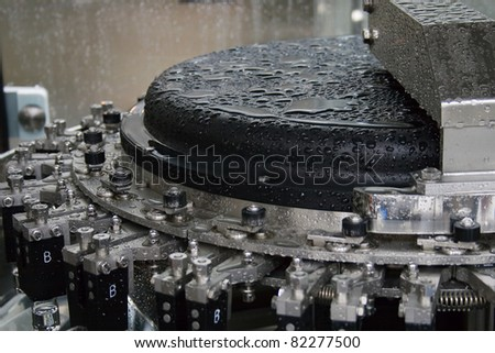 Part of a machine washing bottles at the factory for the production of medicines - stock photo