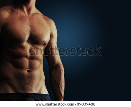 Part of a man's body on a dark blue background with copyspace - stock photo