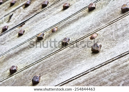 Part of a medieval door with metal studs - stock photo