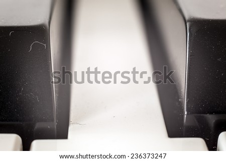 Part of a piano, details of keys in vintage look.  - stock photo