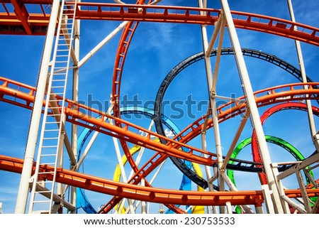 part of a roller coaster in front of blue sky - stock photo
