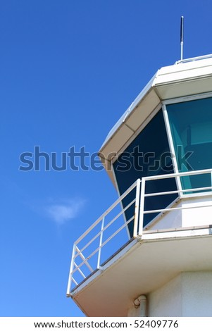 Part of aerodrome control tower against clear sky, with copy space - stock photo