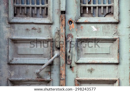 Part of aged shabby door in the capital of Georgia Tbilisi - stock photo