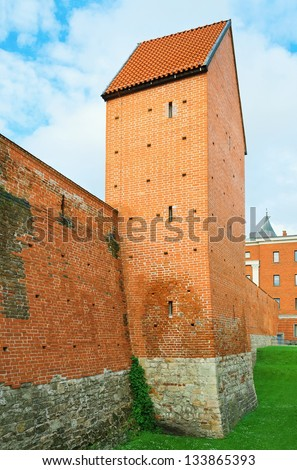 Part of an old fortified wall from red brick in Riga. Latvia - stock photo