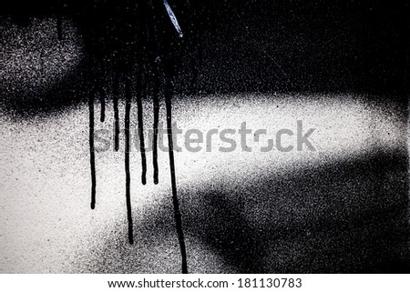 Part of black graffiti spray paint - stock photo