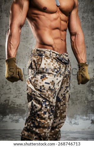 Part of body. Chest and stomach. Army pants - stock photo