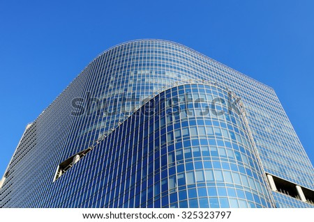 Part of building from glass and metal on a background of blue sky - stock photo