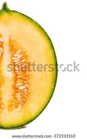 Part of cantaloupe melon halves fresh on a white background - stock photo