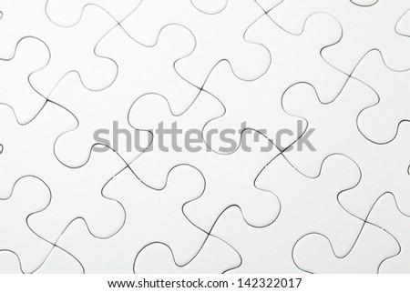 Part of completed white puzzle - stock photo