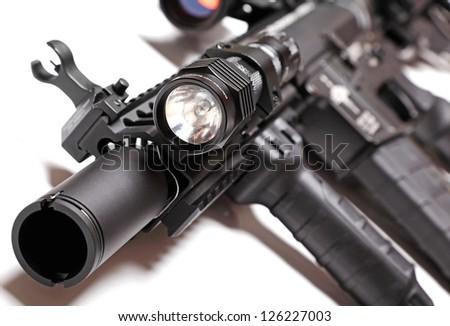 Part of custom build AR-15 tactical carbine with flashlight. Shallow DOF. - stock photo