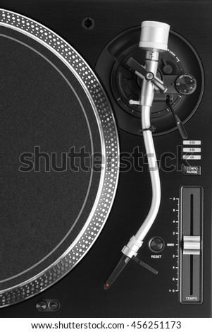 part of dj turntable with tonearm, top view - stock photo