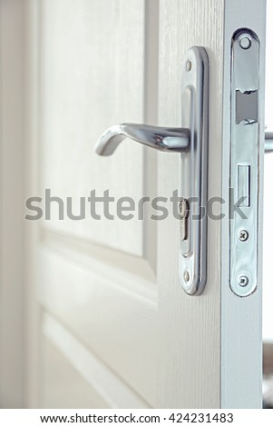 Part of door with silver door-handle - stock photo