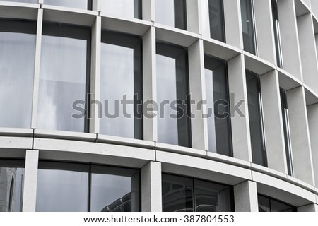 Part of exterior of a modern office building in the UK - stock photo