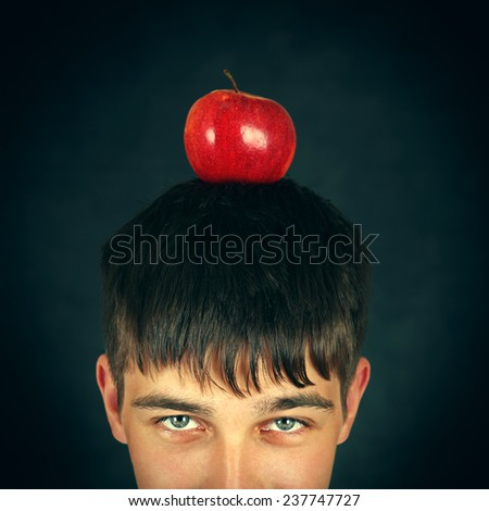 Part of Face of Teenager with an Apple on the Head - stock photo