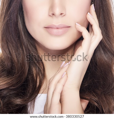 Part of face. Young and beautiful woman with long brown hair. - stock photo