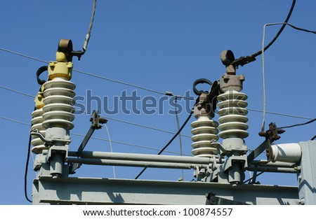part of high-voltage substation on the blue sky background - stock photo