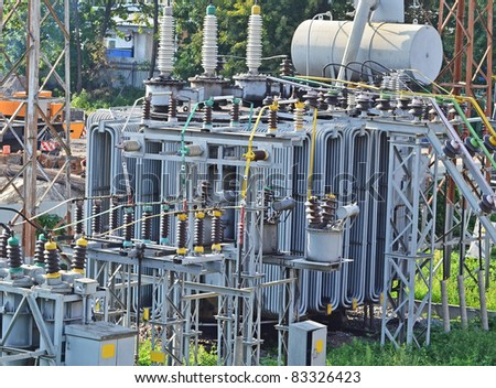 Part of high-voltage substation with switches and dis-connectors - stock photo