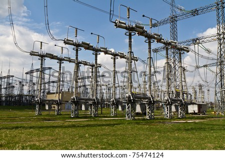 part of high-voltage substation with switches, disconnectors and isolator - stock photo