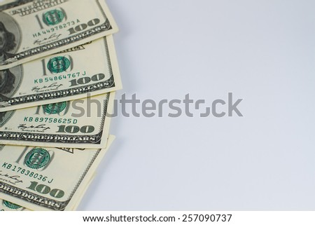 Part of hundred dollar bills on a white background. - stock photo