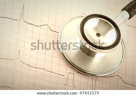 Part of medical stethoscope and electrocardiogram (ECG, EKG) close up - stock photo