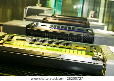 Part of offset printing machine in a firm - stock photo
