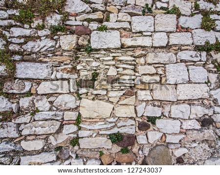 Part of old brick and stone wall , Italy - stock photo
