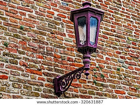 Part of old brick and stone wall, with lamppost, from fortress Kalemegdan, Belgrade, Serbia.  - stock photo
