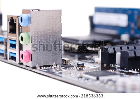 Part of PC main board with USB 3.0 and audio sockets. Closeup with shallow DOF. Isolated on white background. - stock photo