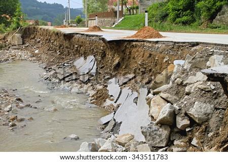 Part of Road Landslide Erosion After Floods - stock photo