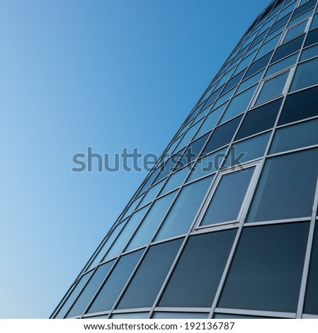 Part of skyscraper glass wall - stock photo