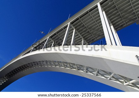 Part of the arch of a concrete bridge, morning light; one of many bridges of Porto - stock photo