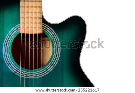 part of the black and green acoustic guitar, isolated on a white background - stock photo