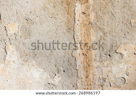 Part of the grange crumbling plaster on the old wall. textural composition - stock photo