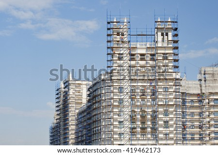 Part of the high-rise building in scaffolding. Photography in Moscow. Stalin skyscraper on Kotelnicheskaya embankment. - stock photo