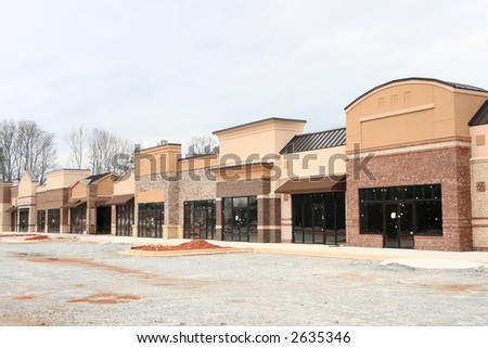 "Part of the ""instant village"" series.  A suburban strip center under construction in Atlanta.  Earth tone varied materials.  A shopping center made to appear like a small village street. - stock photo"