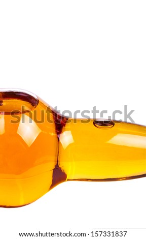 Part of the lying bottle with whiskey without label. Close-up. Isolated on white background. - stock photo