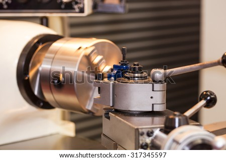 Part of the metalworking lathe in a workshop - stock photo