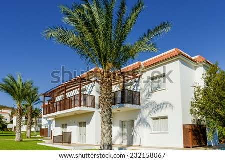 part of the territory of the hotel building with green palm plant - stock photo