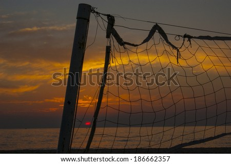 part of the volleyball net at sunset - stock photo