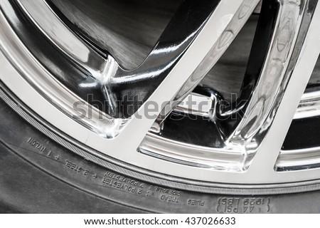 Part of the wheel of a modern car closeup - stock photo