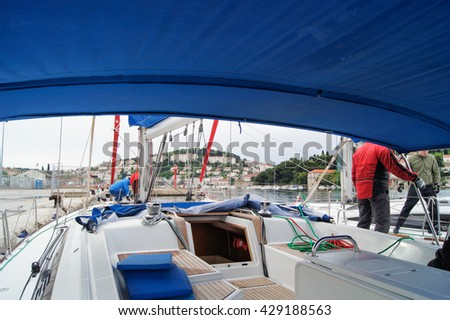 """Part of the yacht with a descent into the cabin. Tivat, Montenegro - 26 April, 2016. Regatta """"Russian stream"""" in God-Katorskaya bay of the Adriatic Sea off the coast of Montenegro. - stock photo"""