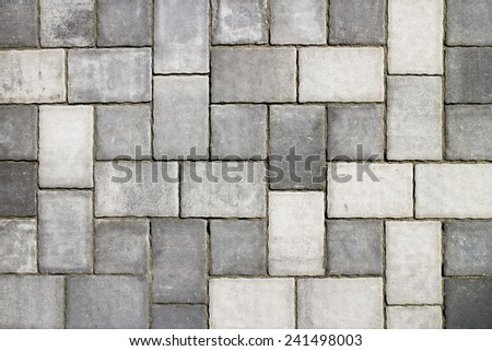 Part of urban street covered with gray concrete cubes - stock photo