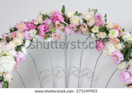 Part of wedding arch with pink and white flowers - stock photo